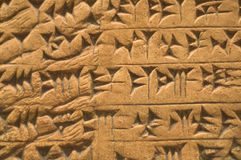 Assyrian hieroglyps on the wall Stock Photo