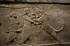Assyrian king killing a lion Royalty Free Stock Images