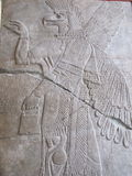 Assyrian Relief with mythological beast. From Palace at Nimrud in Pergamon Museum in Berlin, Germany, Europe Stock Images