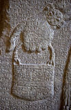 Assyrian wall carving with cuneiform writing Stock Photo