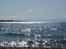 Astérisques solaires sur le lac Photos libres de droits