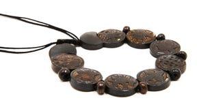 Astamangal Tibetan Bone Necklace. Isolated on white, Astamangal Bone Prayer Necklace from Tibet Stock Photos