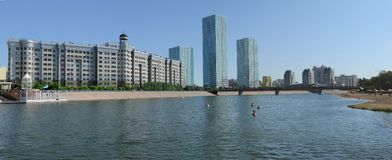Astana. Kazakhstan. Two modern skyscrapers at river bank stock photos