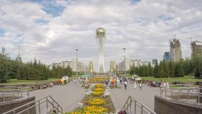 ASTANA - CIRCA SEPTEMBER 2014: Central Asia, Kazakhstan, Astana, Nurzhol Bulvar - Central Boulevard and Bayterek Tower. Illuminated at night- Time lapse stock footage