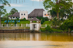 The Astana, or Governor`s Palace, located in Kuching in the Province of Sarawak, the island of Borneo and the country of Malaysia. The view from the water Stock Photography