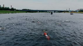 Astana_Kazahstan_-_June_17_2018_Ironman 70.30. Aerial shot of world known sport competition with swimming, running and. Astana Kazahstan - June 17 2018 Ironman stock footage