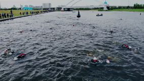 Astana_Kazahstan_-_June_17_2018_Ironman 70.30. Difficult long distance of triathlon competition. Swimming step of stock video