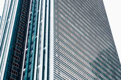 ASTANA, KAZAKHSTAN - APRIL 26, 2018: details of the facade of a modern skyscraper made of glass and steel closeup in the Royalty Free Stock Image