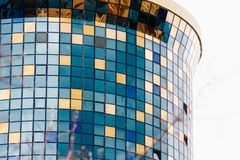 ASTANA, KAZAKHSTAN - APRIL 26, 2018: details of the facade of a modern skyscraper made of glass and steel closeup in the Stock Photos