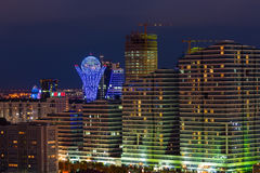 Astana, Kazakhstan - August 25, 2015:High-rise buildings and monument Bayterek at night Royalty Free Stock Photos