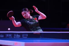 Chen Meng from China top spin. Astana, KAZAKHSTAN, Dec 2017 : Chen Meng from China top spin at the 2017 ITTF World Tour Grand Finals Stock Image