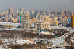 Astana, Kazakhstan - February, 2017 - Area of state symbols with flag of Republic and Palace of Saltanat Sarayy. Astana, Kazakhstan - February, 2017 - Top view stock photo