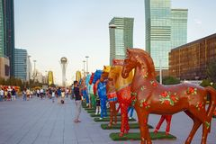 ASTANA, KAZAKHSTAN - JULY 25, 2017: Art installation with figures of horses painted in different ethnic ornament. Art installation with figures of horses painted stock photos