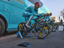 Astana Pro Cycling Team. Houilles,France- March 3rd, 2013: Three cyclists of Astana Pro Team from Kazachstan warming up near the team's truck before the start in Stock Images
