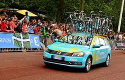 Astana Pro Team (Kazakhstan). London, UK – July 7, 2014: The caravan of the Astana Pro Team (Kazakhstan) arrive at The Mall, approaching the finish line of the Stock Photos