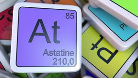 Astatine As block on the pile of periodic table of the chemical elements blocks. 3D rendering Royalty Free Stock Photography