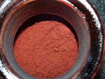 Astaxanthin powder. A close up of astaxanthin powder in a bowl Royalty Free Stock Photo