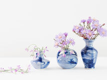 Aster amellus bouquet in vases on white background. Aster amellus bouquet in blue vases on white background royalty free stock image