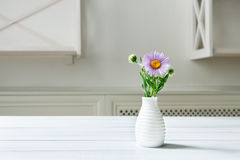 Aster amellus flower bouquet at white table Stock Photography