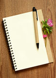 Aster bud on a notepad Stock Photography