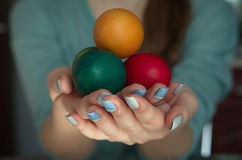еaster egg in hand. Painted eggs in the hands Stock Photography