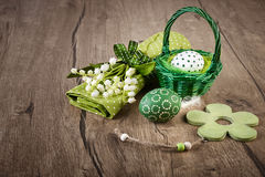 Еaster eggs, lily of the valley and spring decorations on wood Stock Image
