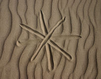Asterisk. Sign in the sand Stock Photo
