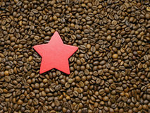 Asterisk on a coffee beans background. Royalty Free Stock Photography