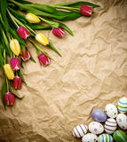 astern egg, tulips on brown crumpled wrapping paper Royalty Free Stock Image