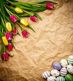 Astern egg, tulips on brown crumpled wrapping paper Stock Images