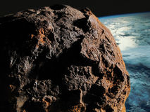 Asteroid against The Earth. Asteroid coming closer dangerously The Earth Stock Photo