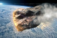 Asteroid approaches the earth stock image