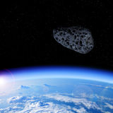 Asteroid approaching Earth Stock Photography