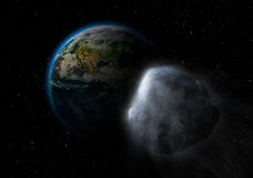 Asteroid on collision path with earth Royalty Free Stock Photos
