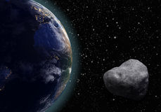 Asteroid and Earth. An asteroid flies around the planet earth on a background of stars. 3D rendering Stock Photo