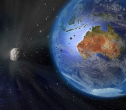 Asteroid Flying By Earth. An illustration of a large asteroid flying closely by Earth. Earth land and clouds texture maps courtesy of NASA.gov Royalty Free Stock Image