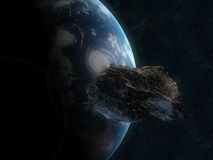 Asteroid infront of the earth Royalty Free Stock Photo