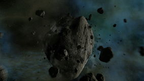 Asteroid traveling in space with camera crossing near it stock video