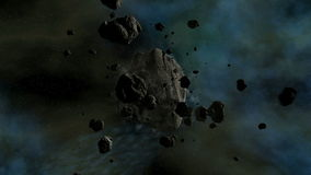 Asteroid traveling in space with slow camera fly trough stock video