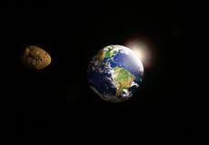 Asteroide delante de la tierra Imagenes de archivo