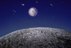 Asteroids. Evocation of asteroids in space on dark blue and stars background Stock Photos