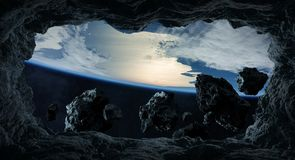 Asteroids flying close to planet Earth 3D rendering elements of. Dark asteroids flying close to planet Earth view from a cave 3D rendering elements of this image Royalty Free Stock Image