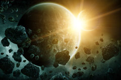 Asteroids over planet earth. Asteroids flying close to the planet Earth Royalty Free Stock Images