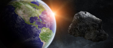 Asteroids threat over planet earth Royalty Free Stock Photography