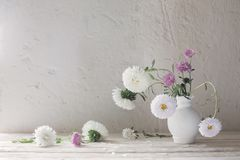 Free Asters And Chrysanthemums In Vase On White Wooden Table Royalty Free Stock Image - 157630026