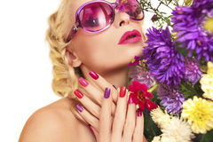 Asters. Colorful makeup and manicure with summer flowers asters on a white background Royalty Free Stock Photo