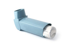 Asthma inhaler. Blue asthma inhaler isolated on white background royalty free stock image