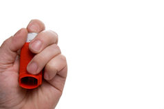 Asthma Inhaler. A person holding an asthma inhaler filled with albuterol sulphate Stock Image