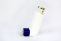 Asthma Inhaler. A background with a view of an inhaler used for asthma medication, on a white fabric Stock Photos