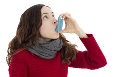 Asthma inhaler. Adult woman with asthma using inhaler to breathe better stock images